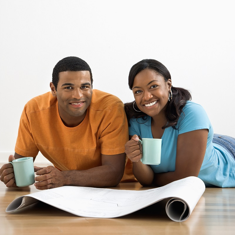 African American male and female couple with architectural  blue